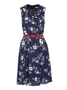 A perfect summer style, this light and lovely sleeveless midi-length dress has a Peter Pan collar that knots in a sweet bow at the chest, and a luminous red and white silhouette floral print against a navy base, set to light up any evening. Lined for total comfort.
