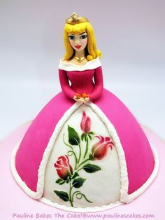 Made this Princess Aurora cake for a little girl Calleigh's birthday yesterday. Her head and upper body is entirely hand modeled from gumpaste whereas her skirt is fondant iced cake. She comes complete with gold tiara, golden blond hair, gold choker, butterfly fluttering in the palm of her hands and painted roses on her underskirt.    -- Pauline Bakes The Cake! http://www.facebook.com/paulinescakes