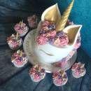 Pastel pink unicorn cake and cupcakes