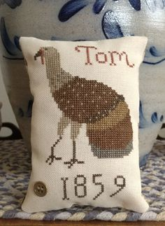 Primitive cross stitch Thanksgiving pillow with turkey. Design is one by Tina Woltman that I altered a little.