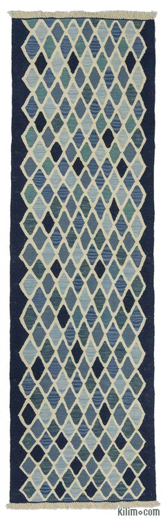 New Turkish Kilim Runner Rug with blue and navy tones. This lovely kilim is hand-woven in Konya, Turkey with vegetable-dyed and hand-spun wool. The fringes can be removed upon request. If you like the design of this rug, we can custom make it to meet your color and size requirements.
