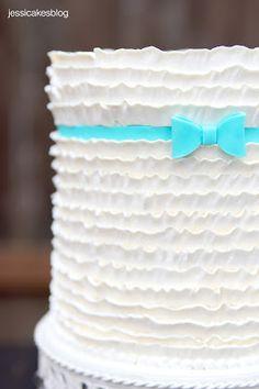 buttercream ruffles, fondant or modeling chocolate ribbon & bow
