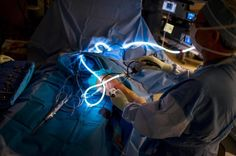 Orthopedic surgeon Eric Guidi uses arthroscopic instruments to repair a torn meniscus at the Massachusetts Avenue Surgery Center.
