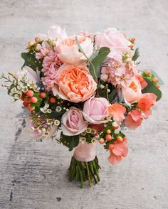 Floral Bouquet Recipes by Colour Not the biggest fan of ALL the coral. I would replace that with cream/white. BUT I love the Juliet rose, the wax flowers, and the silver dollar eucalyptus Bride Bouquets, Floral Bouquets, Flower Bouqet, Bouquet Of Roses, Garden Rose Bouquet, Ranunculus Bouquet, Peach Bouquet, Purple Bouquets, Tulip Bouquet