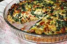 Kale Quiche with a Quinoa Crust.. I would add some chicken, sausage, shrooms or even some smoked salmon.  Basics are here though.