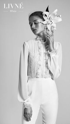 These Livné White Wedding Dresses are Perfect for the Modern Bride | From Alon Livne 2018 & 2019 White Bridal Collections. Full story: Wedding Inspirasi / / Long poet sleeves high neck heavily embellished bodice modern shirt and pants wedding dress (valencia) mv // #LivneWhite #AlonLivne #Ad #Wedding #WeddingDress #WeddingGown #Bridal #WeddingDresses #WeddingGowns #ChicBride #ModernBride #Strapless #ModernWeddingDress