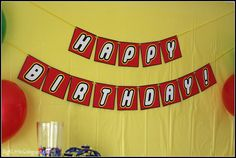 "Free Printable Banner ""Happy Birthday"" (the white Lego font letters with yellow outline). Then she cut them out and pasted them on red card stock."