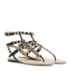 Valentino - Rockstud leather sandals - Valentino updates its 'Rockstud' sandals with classic black and a powder-pink insole, which offers a resolutely girlish finish to the tough-luxe style. These will provide an instant upgrade to your summer shorts, skirts, dresses and denim alike. seen @ www.mytheresa.com