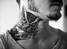 Owl on man's neck tattoo.
