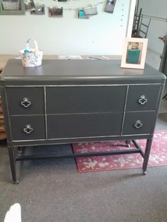 Very dark gray buffet with silver accent