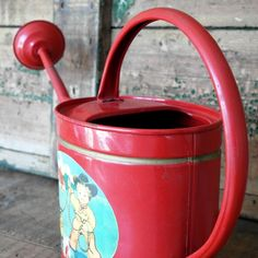 LITTLE VINTAGE BRIGHT RED CHILDS WATERING CAN, £25.00