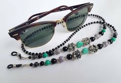 'On the Spot' Beaded Eyeglasses Chain 'On The Spot' Made out of Snow Obsidian, Ceramic, Agate, Larvikite beads and metal inserts Length: 80 cm This item comes in original 'Buddha Touch' box Handmade Accessories, Eyeglasses, Buddha, Sunglasses Holder, Chain, Metal, Bracelets, Agate, Snow