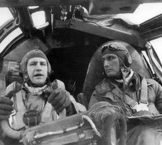 Heinkel 177 pilot and co-pilot both wearing  summer flying helmets LKp S 100. Pilot has shatterproof goggles and a harness with central connecting box for parachute 30 I, worn over winter flying suit KW 1/33.