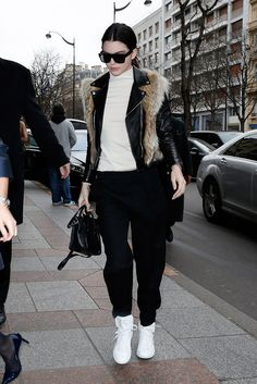 Kendall Jenner stayed comfortable on the streets of Paris in white sneaks, loose fitted pants, and a black leather jacket. She finished off the look with a touch of fur and shades.  Source: Getty / Pierre Suu