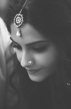 Sonam Kapoor wears a pretty nose stud and maang tikka.