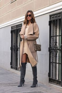 "justthedesign: ""Grey will go well with almost any other colour. Silvia Zamora matches grey over the knee boots with an otherwise camel outfit consisting of a wrap coat, knitted sweater, and..."