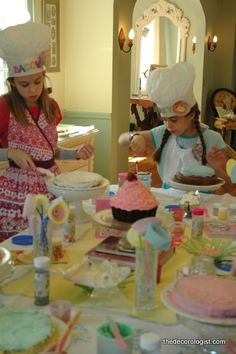 Cake decorating party, with aprons and cakes as favors to take home. Totes brills.