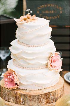 white ruffle wedding cake #weddingcake #ruffledcake #weddingchicks http://www.weddingchicks.com/2014/02/20/casual-elegance-wedding-for-under-7k/