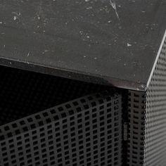 GRID CABINET - the Grid Cabinet is made of perforated steel and has a beautiful black marble plate on top. An elegant cabinet with a semi-transparent design.