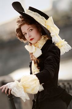 Beautiful frothy lace on hat and sleeve. Double ruffled peplum is a nice touch on the jacket.