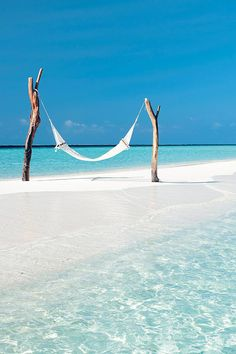 Hammock at tropical turquoise beach | Constance Moofushi Resort, Maldives via Vacation Idea