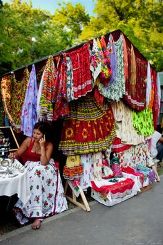 A gypsy woman selling traditional gypsy clothes on the market in Romania
