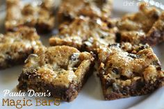 PAULA DEEN'S MAGIC BARS  1 lb. frozen or fresh cookie dough (I used this recipe, but you could also use a package of refrigerated dough)    1 cup semi sweet chocolate chips    1 cup butterscotch chips    1 cup toffee bits    1 cup chopped pecans    1 can sweetened condensed milk