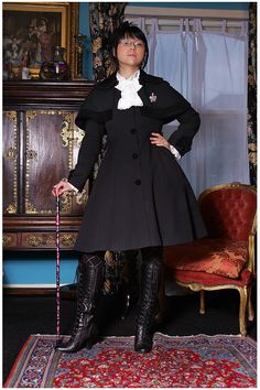 This is part of fashion photoshoot taken by Pat Lyttle last year in a boutique hotel in London. Myself and two other girls had lots of fun showing off our gothic and lolita wardrobes!  (Jabot blouse and coat, Innocent World. Headdress - Bodyline)