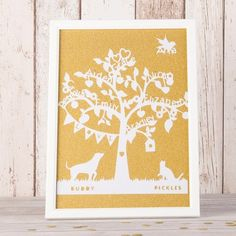 Our beautiful Family Tree Framed Papercut is lovingly handcrafted using papercut techniques and comes framed. You can add up to 10 names and an optional dog and/or cat for truly bespoke artwork. Shop now! Personalised Family Tree, Personalized Wall Art, Personalized Christmas Ornaments, Christmas Tree Ornaments, Tree Cut Out, Wall Art Prints, Framed Prints, Family Tree Frame, Beautiful Family