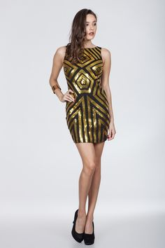 Midnight Kiss Dress - Never Go wrong with sequin on NYE! Always appropriate and sure to make you the life of the party! This dress features gold and black sequins in a great geometric pattern. The dress has a flattering fit. Lastly, Pair with black sandals or pumps for a true dazzling effect.