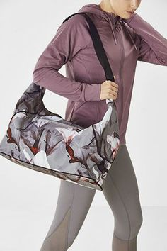 Getting to the gym is the hardest part of working out, so why not make the commute cute with our stylish gym bag. It features a removable shoe bag, zippered closure and plenty of pockets to organize your gear. So long excuses! Designer Backpacks, No Equipment Workout, Yoga Pants, Wetsuit, Gym Bag, Zipper, Shoe Bag, Clothes For Women, Stylish