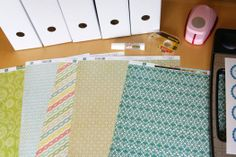 use scrapbook paper to cover the face of the magazine file. IKEA magazine file (1.99/5 pack)