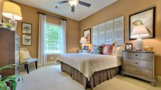 Colorful accent touches and designs by Darling Homes at Woodforest. #bedroomcolors #walldesign