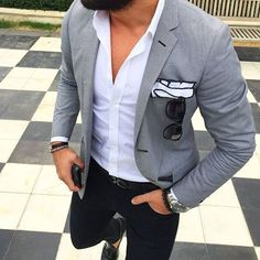 Consider teaming a grey sport coat with black pants for a dapper casual get-up. Feeling inventive? Complement your outfit with black leather tassel loafers. Shop this look on Lookastic: https://lookastic.com/men/looks/blazer-long-sleeve-shirt-chinos/21025 — White Long Sleeve Shirt — Grey Blazer — White Pocket Square — Black Leather Belt — Black Chinos — Black Leather Tassel Loafers