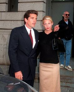 John F. Kennedy Jr. and Carolyn Bessette Kennedy return to New York after their 2 week honeymoon, October 1996; By Globe Photos, Inc.