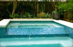 Arctic lagoon 1x2 tile with medium grey grout and white thin set. Poolside contemporary-pool