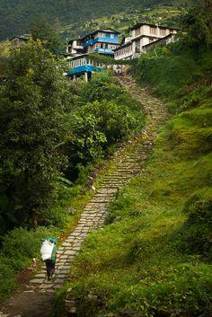 Porter Bringing goods to a village - Annapurna Sanctuary Trek, Nepal By Simon Christen