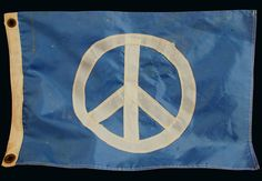 Handmade late 1960s- early 7-s Hippie Peace Flag which was used at an estimated 50 anti-war protests by a protester who was arrested twice. It was also flown from the back of a motorcycle en route to national protests.