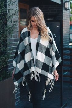 This Buffalo Plaid poncho is everything you have been looking for! This poncho features a plaid buffalo checkered fabric with fringe along the hem.This poncho will be warm and stylish from dusk till d