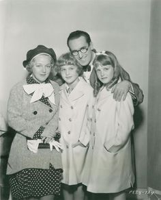 Harold Lloyd is visited by wife Mildred Davis and daughters Peggy and Gloria on the set of The Milky Way (1936) (Peggy was adopted) They also had a son Harold Lloyd Jr.
