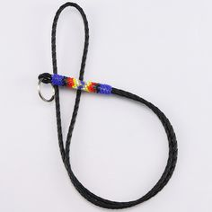 Great way to carry around your keys. Navajo artist Charlene Jackson hand beaded this marvelous key chain lanyard. Great colors that compliment the patterns. 33 1/4″ x 1/2″ x 5/8″ Artist card included