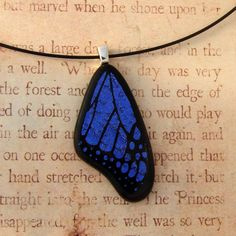 Medium Purple Fused Glass Butterfly Wing Pendant ( Etsy:: www.etsy.com/... ) also really love! Love the photos against a book