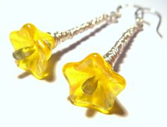 $14 , wire wrapped, yellow Czech Glass beads.  http://www.artfire.com/ext/shop/product_view/amijusartdesign/66745/pure_water-_bright_yellow_and_bright_silver/handmade/jewelry/earrings/glass