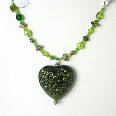 Green Metal Pendant Necklace with Swarovski Pearls by Pookledo, £10.00
