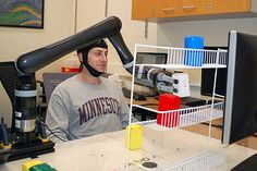 University of Minnesota research shows people can control a robotic arm with only their minds # # Minnesota Colleges, University Of Minnesota, Bras Robot, Robot News, Nature Research, Motor Cortex, Georgia Institute Of Technology, Learning Techniques, Robot Arm