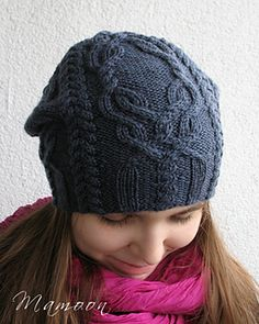 Favorki is a slouchy hat with four cable panels. Free ravelry pattern