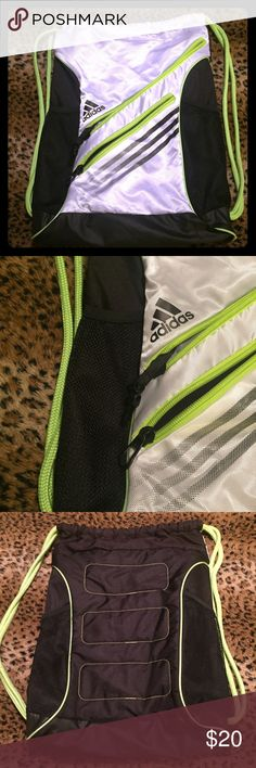 adidas Drawstring Sports Gym Bag 💪🏼 Large adidas Drawstring Sports Gym Bag 💪🏼 Large size.            - Black and white white bright green accents.                    - Padded backing                                                                   - Two compartments inside one with a zipper                       - used once, like brand NEW!!!                                              -100% Polyester Adidas Bags Backpacks