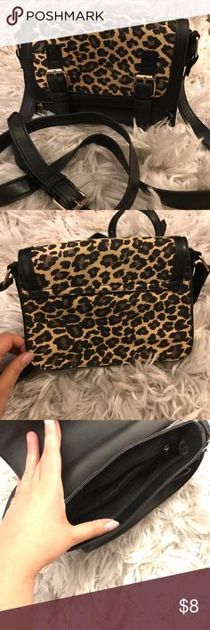 Cheetah Print cross body structured cheetah/leopard print cross body. Never carried, just stored but overall looks amazing & super fun accessory. Wet Seal Bags Crossbody Bags