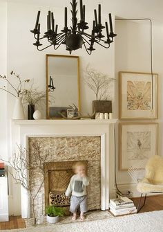 love the dcor around the fireplace and the height of the pictures