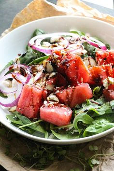 This salad is jam packed with everything cheesy, salty, juicy sweet and more – sweet watermelon, creamy/salty feta, pungent onion slices, crunchy almonds, and tangy dressing. It's SO good!